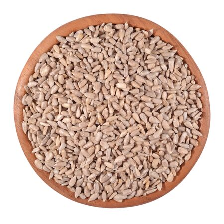 cleared: Cleared sunflower seeds in a wooden bowl on a white background Stock Photo