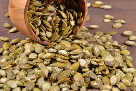 cleared: Cleared pumpkin seeds in a wooden bowl