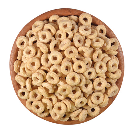 fortified: Breakfast cereal rings in a wooden bowl on a white background Stock Photo