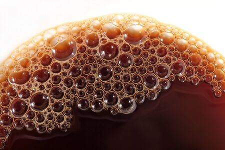 wakening: Bubbles of foam instant coffee on a white