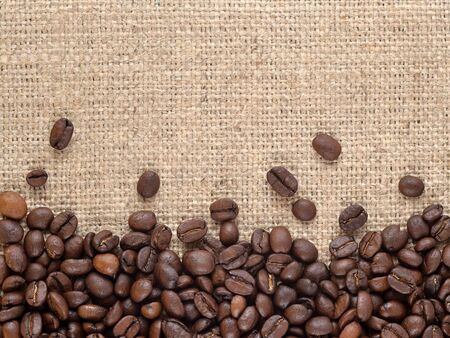 sacking: Natural brown and well-roasted coffee beans in a sacking background