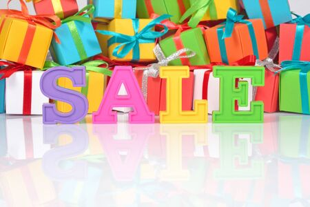 thrifty: Sale written by colorful letters on the background of varicolored gifts