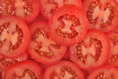 Plakjes tomaat als achtergrond textuur