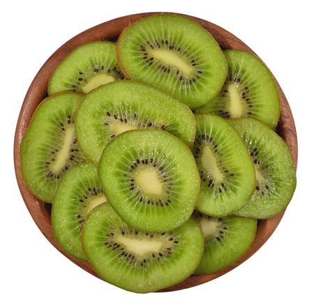 freshest: Sliced kiwi fruit in a wooden bowl on a white background