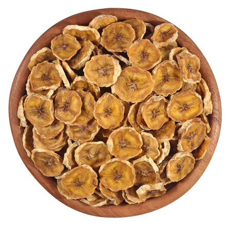 Dried bananas in a wooden bowl on a white background photo
