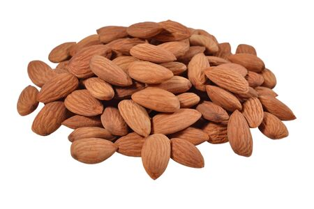Heap of peeled almonds on a white background photo