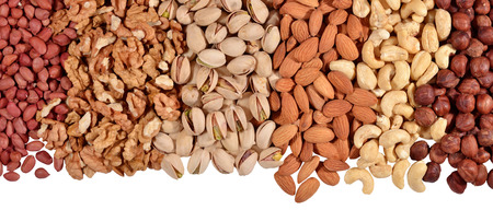 pistachio: Heap of assorted nuts on a white background