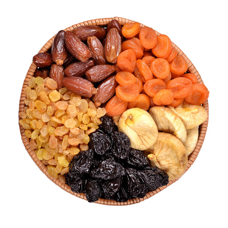 mellow: Various dried fruits in bowl on a white background Stock Photo