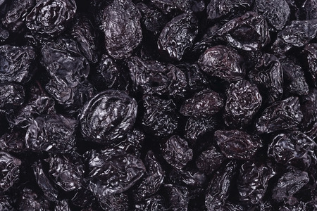 prunes: Top view of prunes as background texture Stock Photo