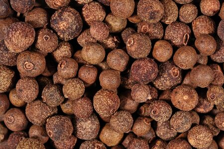 Allspice close up as background photo