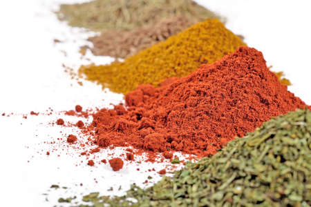 heaps: Heaps of different dry spices on a white background