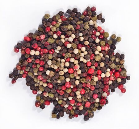 Heap of colored pepper on a white background photo