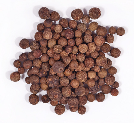 allspice: Heap of allspice on a white background Stock Photo