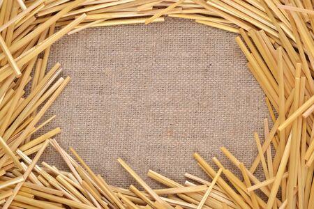Frame of straw on burlap photo