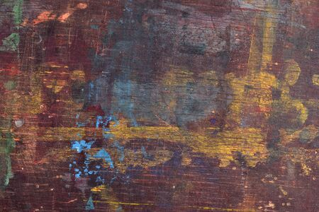 Old wooden board with paint stains as background texture photo