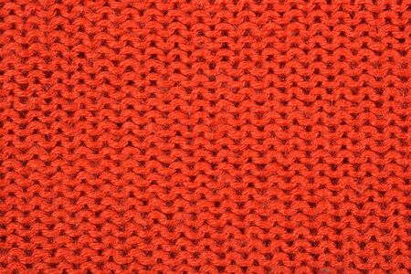 tricot: Orange knitted fabric texture background