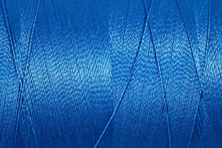 fibrous: Spool of thread macro background texture