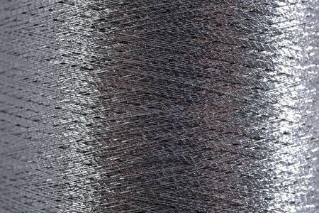 Spool of thread macro background texture