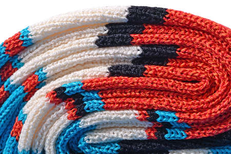 tricot: Stack of colourful knitted on a white background