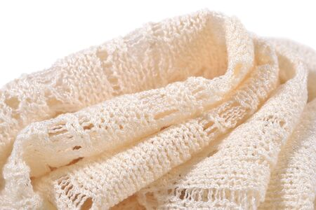 tricot: Stack of white openwork knitted fabric close up