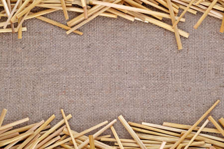 Straw on burlap and copy space. photo