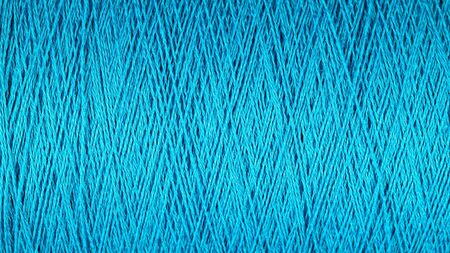 spool: Spool of blue thread macro background texture