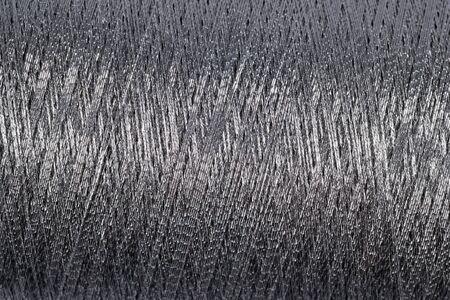lurex: Spool of thread macro background texture