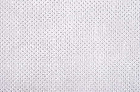 fabric patterns: White nonwoven fabric texture background Stock Photo
