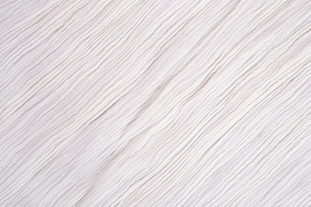 Crumpled white fabric as background texture