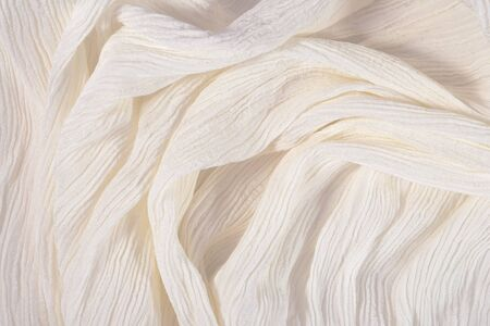 Crumpled white fabric close up as background