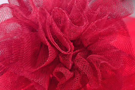 Red crumpled tulle close up as background