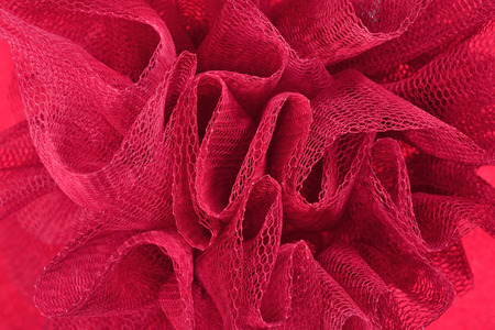 tulle: Red crumpled tulle close up as background
