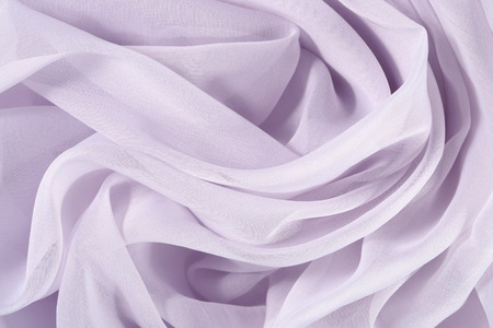 rumple: Lilac crumpled fabric as background texture
