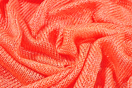 tricot: Orange crumpled stockinet as background