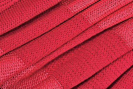 tricot: Red crumpled stockinet as background Stock Photo