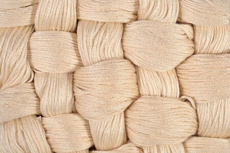 texture twisted: Beige twisted skeins of floss as background texture close up
