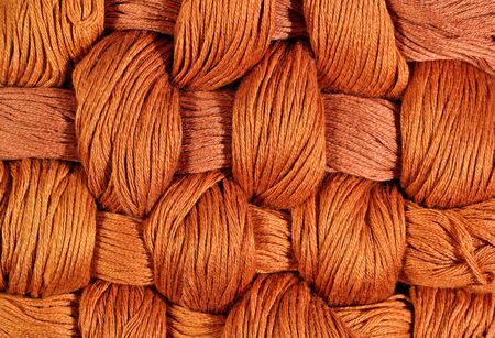 texture twisted: Brown twisted skeins of floss as background texture close up Stock Photo