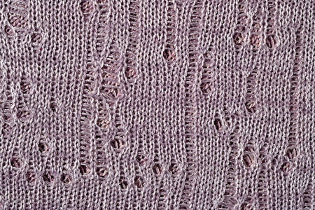 cosiness: Gray openwork melange stockinet as background texture