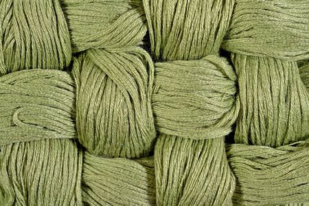 texture twisted: Green twisted skeins of floss as background texture close up
