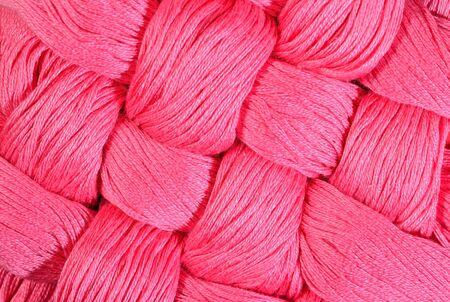 texture twisted: Pink twisted skeins of floss as background texture close up Stock Photo
