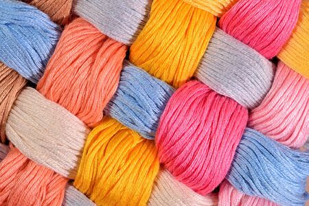 texture twisted: Colorful twisted skeins of floss as background texture close up Stock Photo