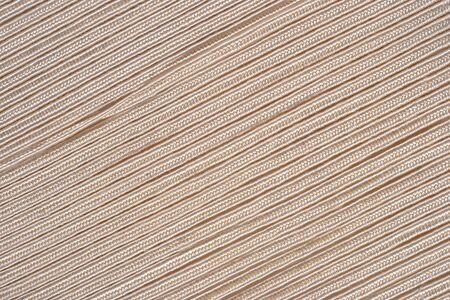 braided flexible: Beige cord as background texture close up