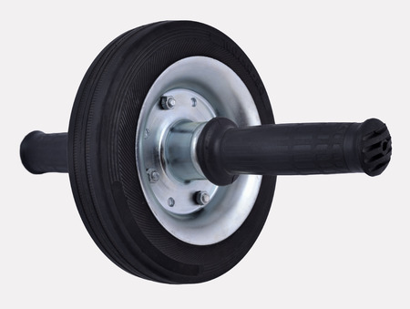 abdominals: Roller wheel for abdominals on a white background Stock Photo