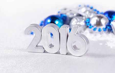 the silvery: 2016 year silver figures on the background of silvery and blue Christmas decorations Stock Photo