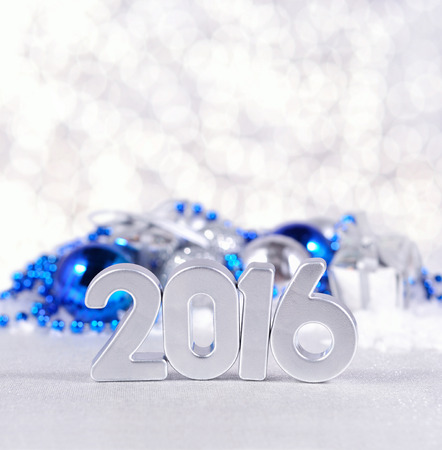 silvery: 2016 year silver figures on the background of silvery and blue Christmas decorations Stock Photo