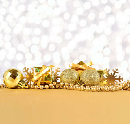 silvery: Golden Christmas decorations on a silvery background
