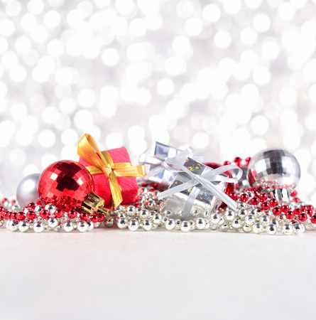 the silvery: Silver and red Christmas decorations on a silvery background