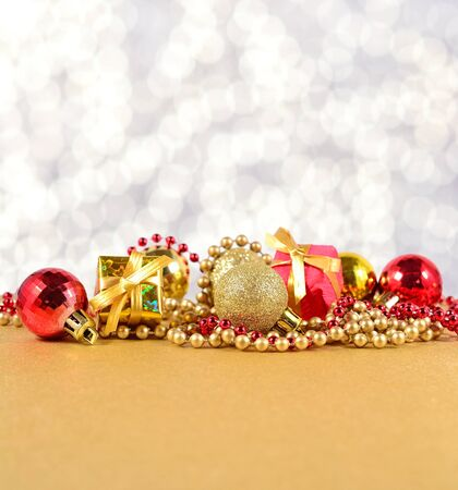 the silvery: Golden and red Christmas decorations on a silvery background