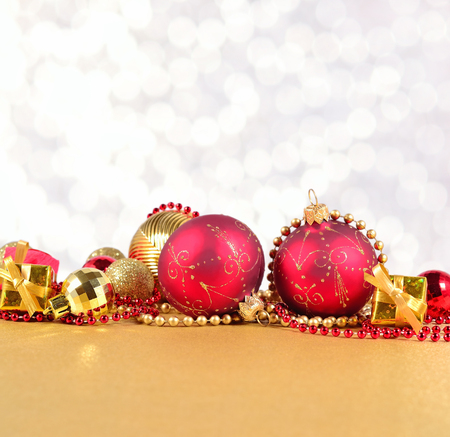silvery: Golden and red Christmas decorations on a silvery background