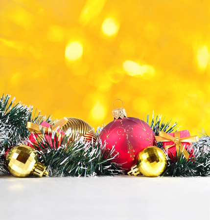 argent: Christmas decorations on a golden bokeh background Stock Photo